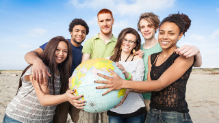 Young adults holding a globe